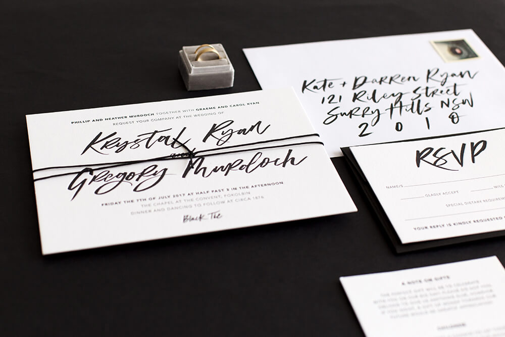 Ebony - The Ebony suite boldly captures attention with modern minimalism and unrestrained brush lettering.