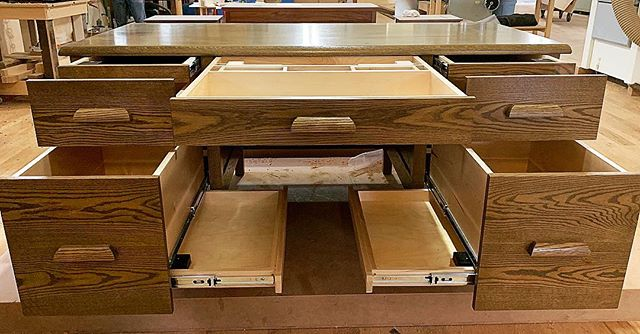 A still frame of just how many completely hidden compartments we can fit into one piece of furniture. Not in the market for a desk? We build all kinds of furniture with hidden compartments: floating shelves, nightstands, coffee tables, dining tables (we make custom chairs as well), mirrors, bureaus, bookcases, entertainment centers, china cabinets, we even can come to you and build a secret passage in your house! If you think an idea is too crazy, you're probably wrong- you just haven't met us yet 😉  Visit our website and pique your curiosity, then give us a call and up your security game 💪🏼💪🏼💪🏼 • • • #hidden #hiddencompartment #hiddeninplainsight #furniture #furnituredesign #heirloomfurniture #bespokefurniture #handmadefurniture #secretagent #jamesbondstyle #interiordesign  #tacticalgear #security #homesecurity #homedefense #antitheft