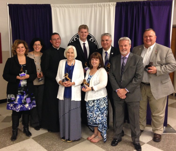 Pictured, from L to R: Christine Julian '85, Jennifer Myers '86, Fr. Stash Dailey '00, Mary Callaghan (posthumously - Jerry Callaghan), Mike Duffy '88, Dominic Tiberi '77, Mary and Ed Miller (posthumously - Ryan Miller '03), Patrick Chapman '84