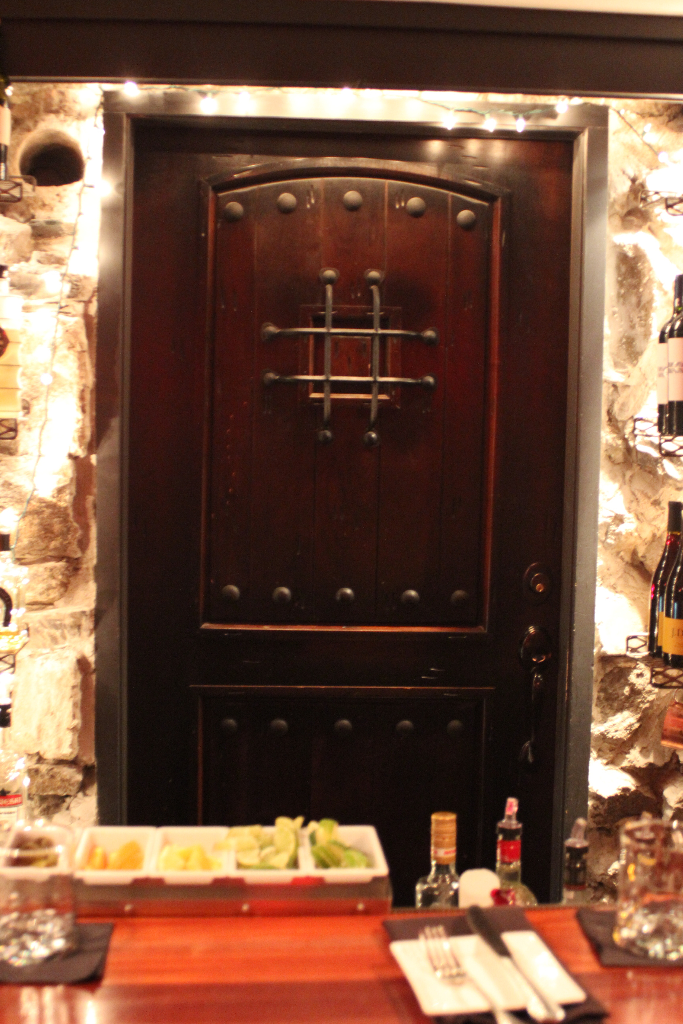 Magnificent door that exists behind the bar in the Wine Cave