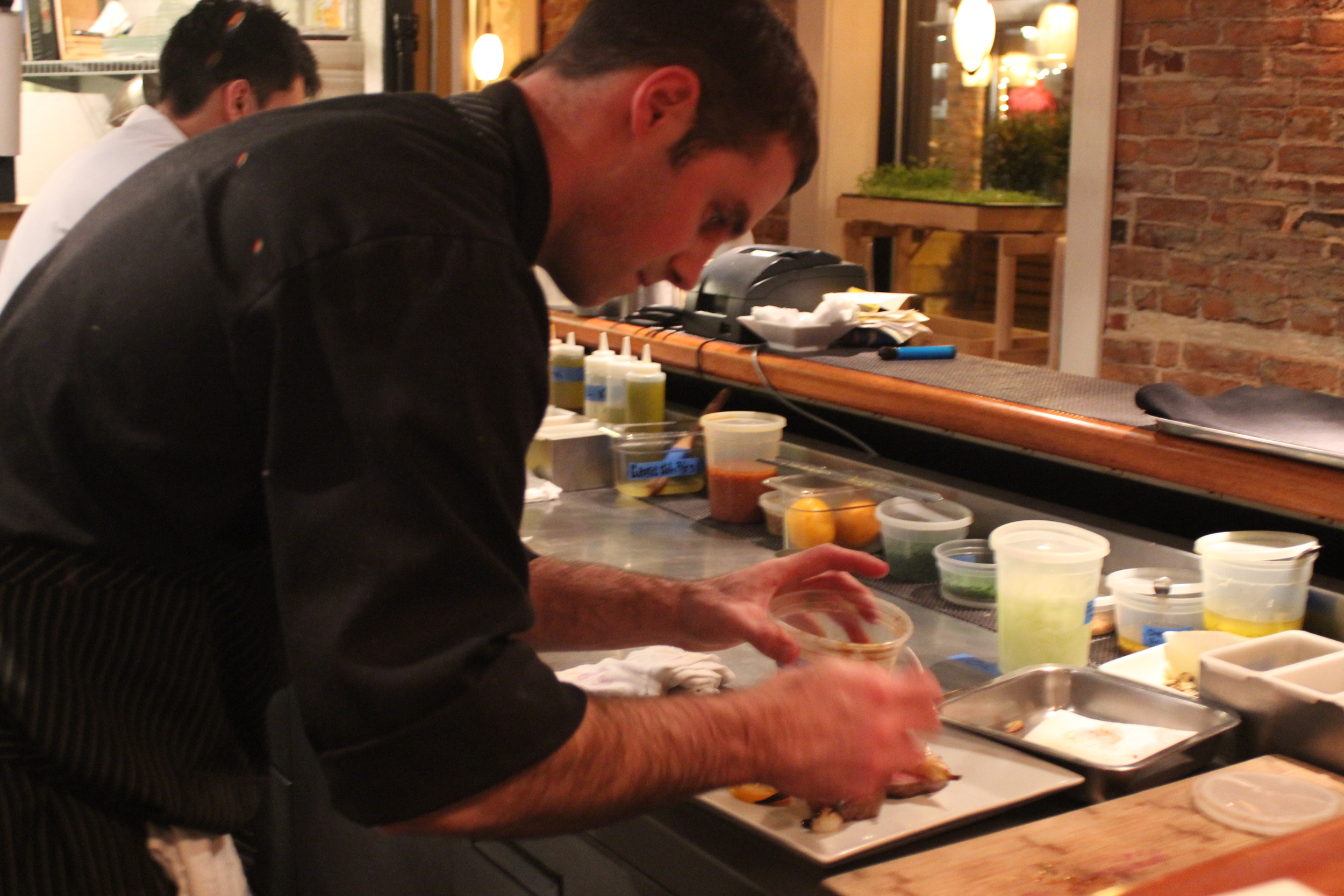 Gregg Sessler, Proprietor and Chef of Cava, prepares the Beef Sirloin