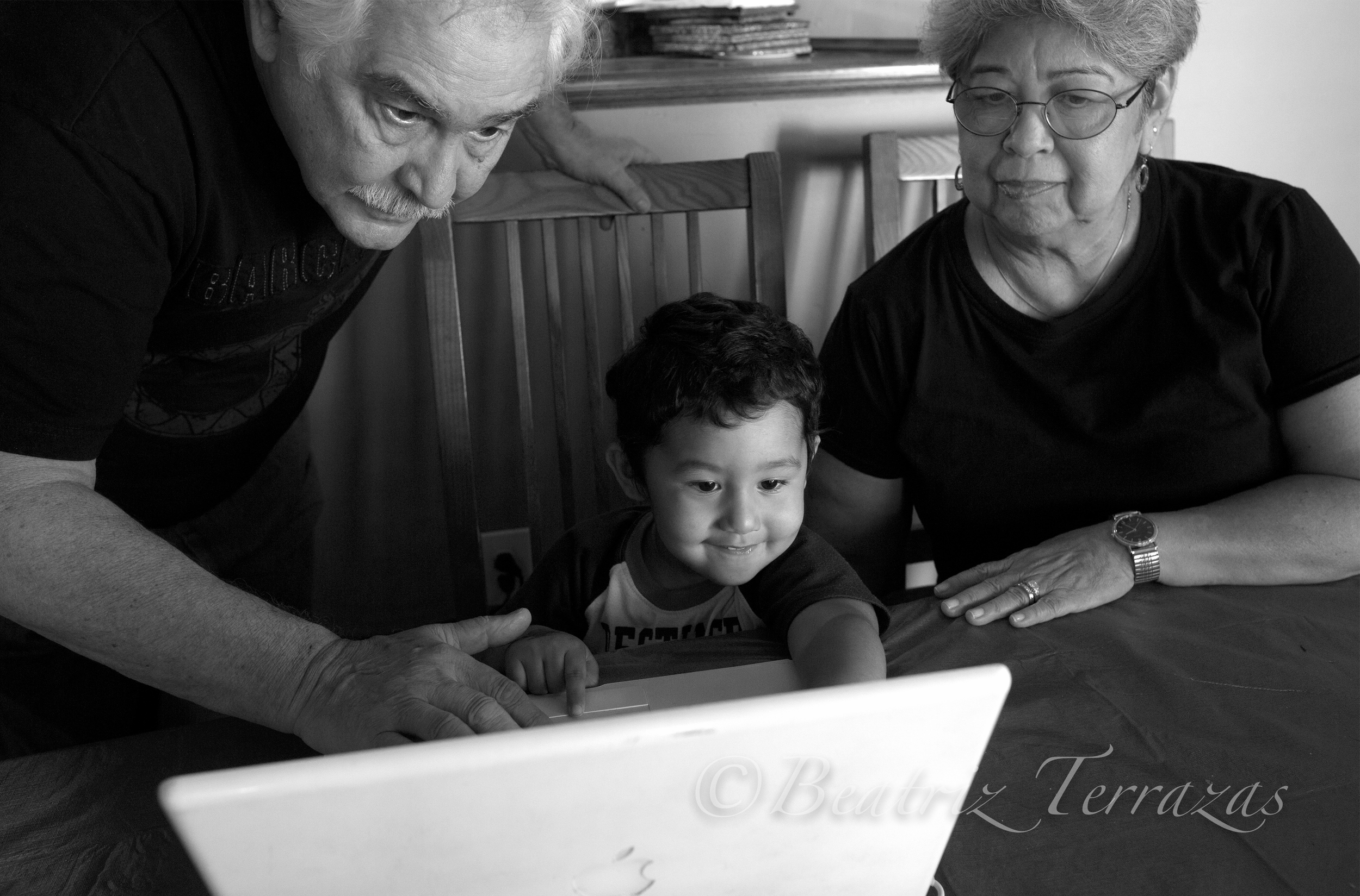 Rita (right) with her husband Michael Utt (left) and their great-grandson, also named Michael.