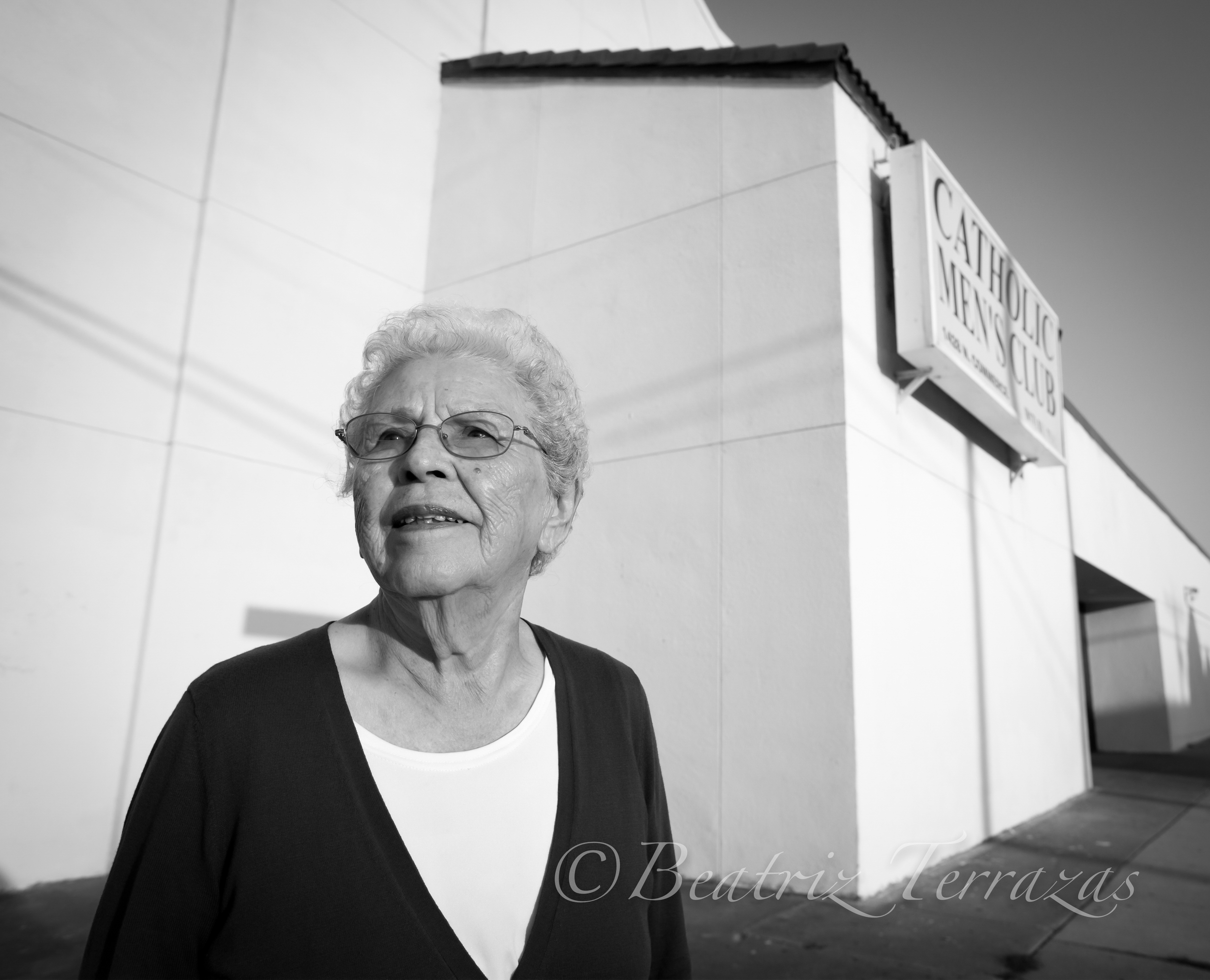 Esperanza stands in front of the Catholic Men's Club, which used to be the San Jose Catholic Church, the heart of religious and social life in the Fort Worth neighborhood where she grew up.