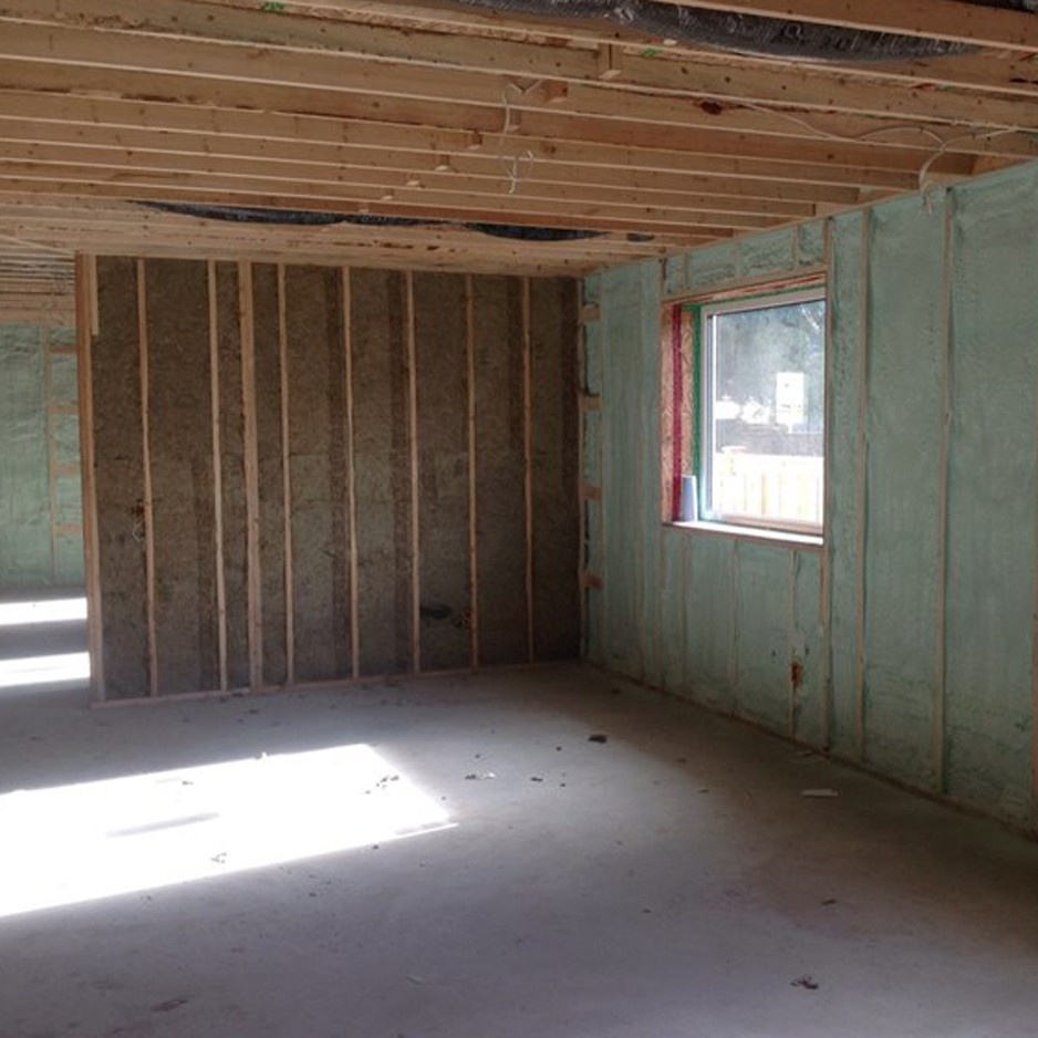 Service wall filled with 2lb spray foam at the Tsawassen passive house.