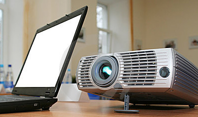 laptop-with-computer-projector-on-table-thumb5606682.jpg