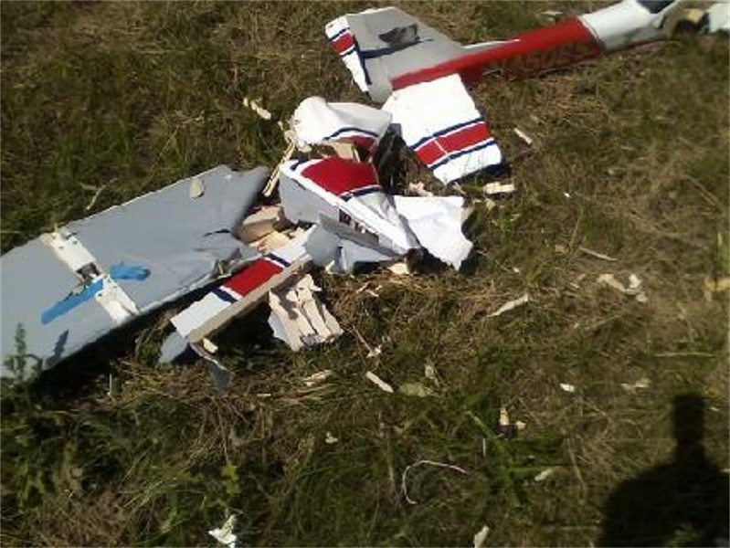Whats left ot the fuselage and wing- was about 4 feet from the impact 08-04-2013.jpg