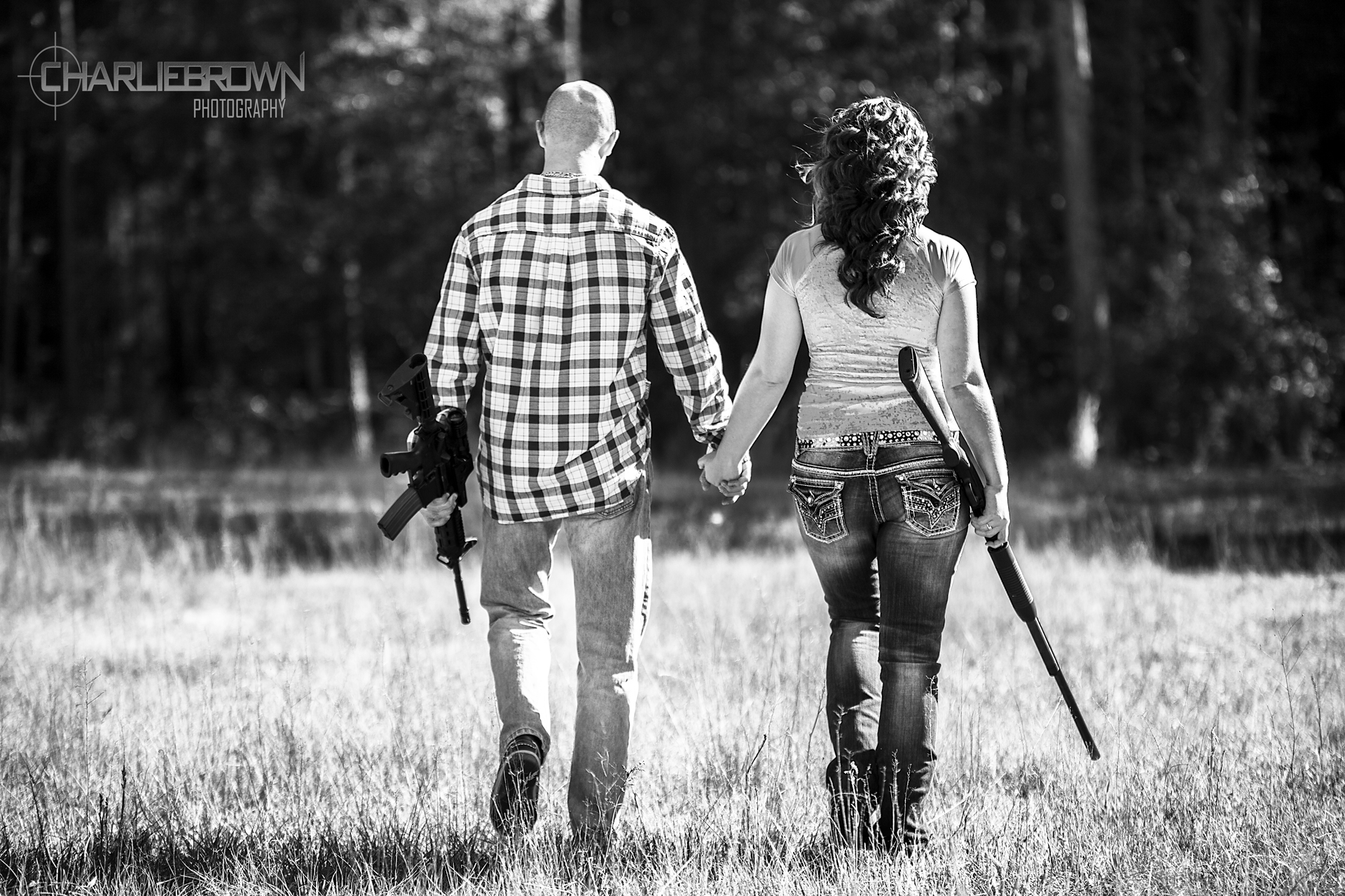 Black and white gun engagement portrait