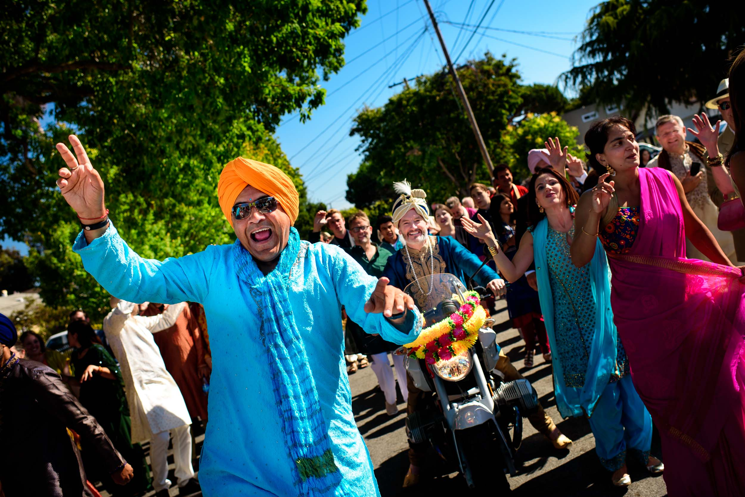 Groom riding a bike for his baraat