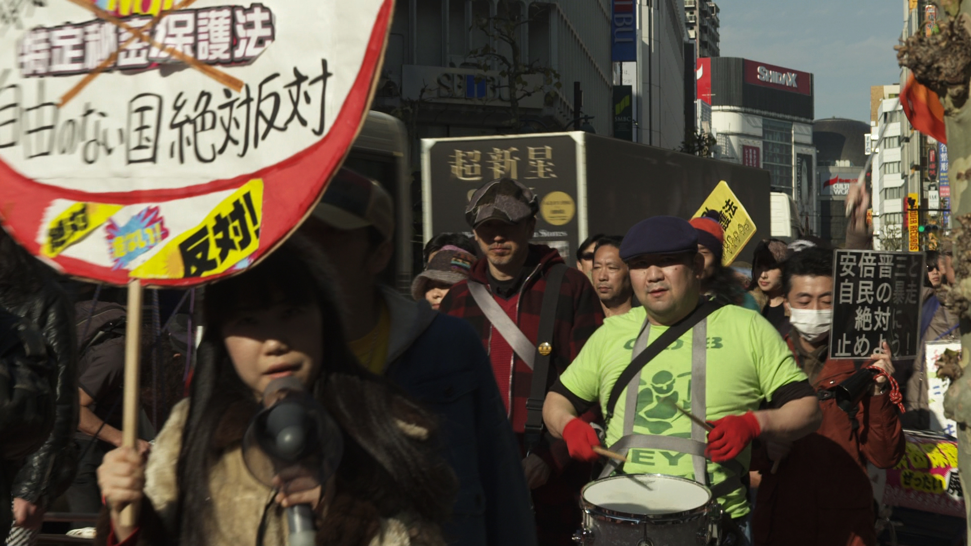 Protestors marching through Shibuya.