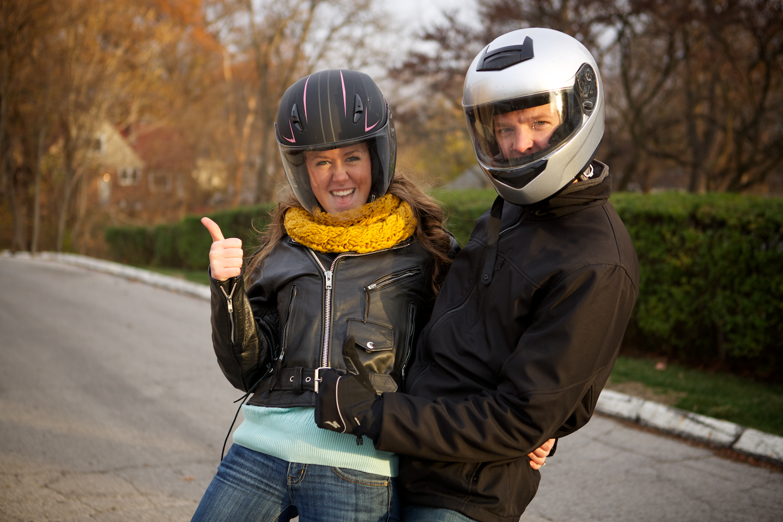 I owa Fire Station in Windsor Heights. Engagement session at the fire station with a fire fighter. Engagement session with motorcycle. On a ride with a motorcycle. Motorcycle helmets.