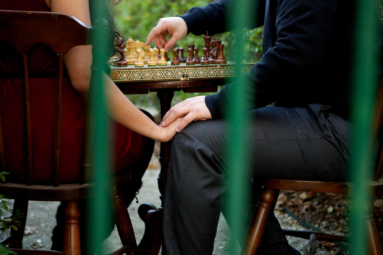 t ire swing, Winterset, Iowa, farm, bridge, hedge maze, chess, chess set, adventure, props, castle, playing chess, engagement session