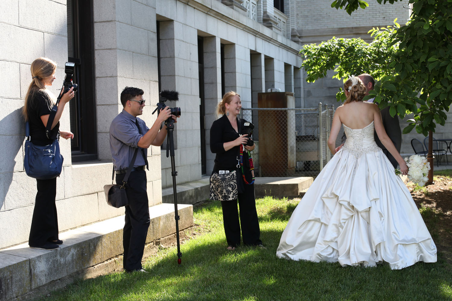 Some of Sara's great team (From left to right Rhiannon, Brad, and Crystal.) & Check out that bustle. ;)