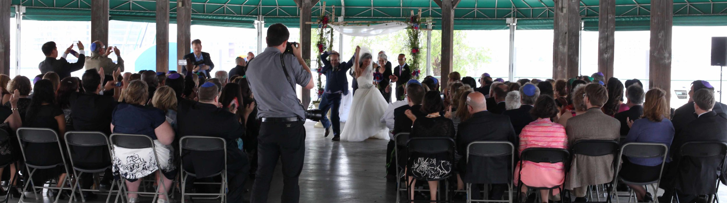 """Deetza and Bill are united and dance a joyful dance down the aisle. Deetza's name is Hebrew for """"The joy that comes from dancing"""".  LOVE. IT."""
