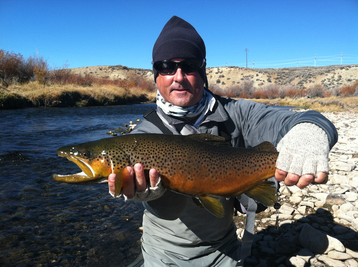 Mike with a brown trout, River x in the fall