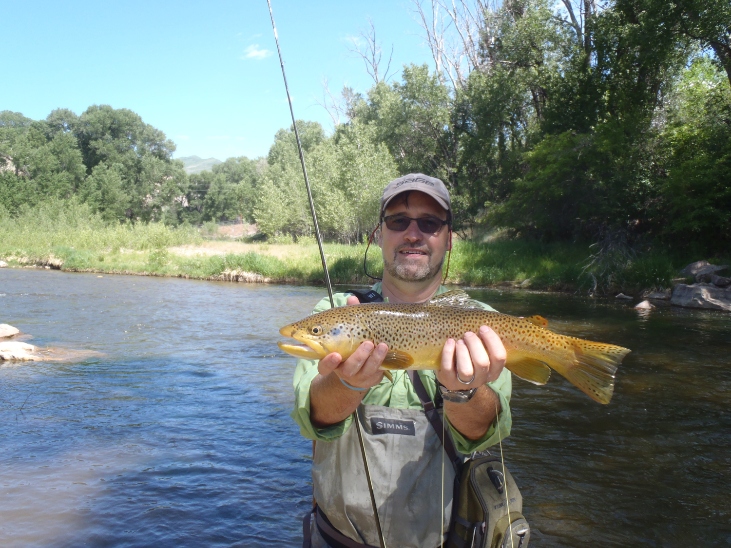 Charlie with a nice brown caught on a dry   small stream in Utah