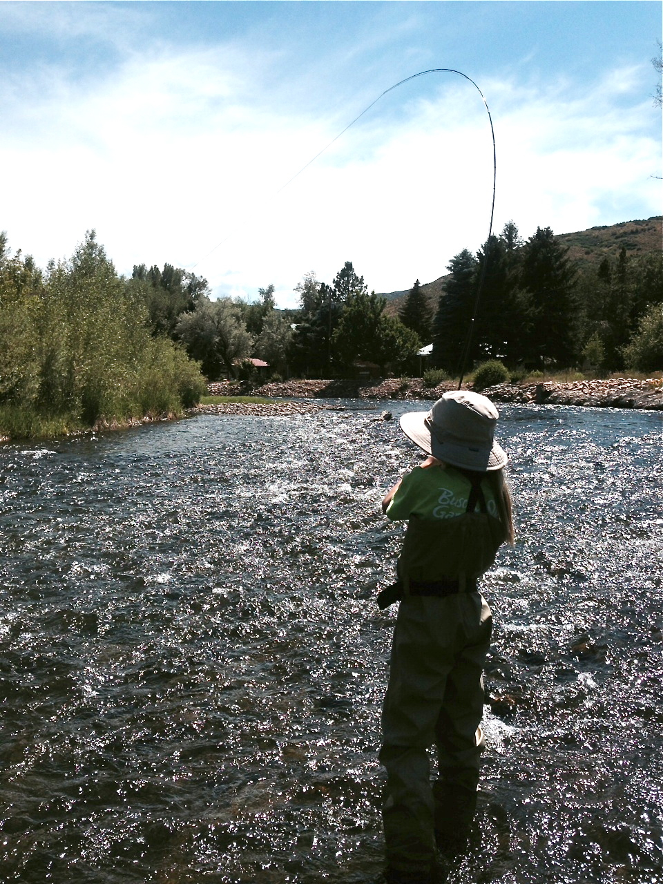 """Emma, age 11, hooked up on a nice 18"""" brown on the Weber River"""