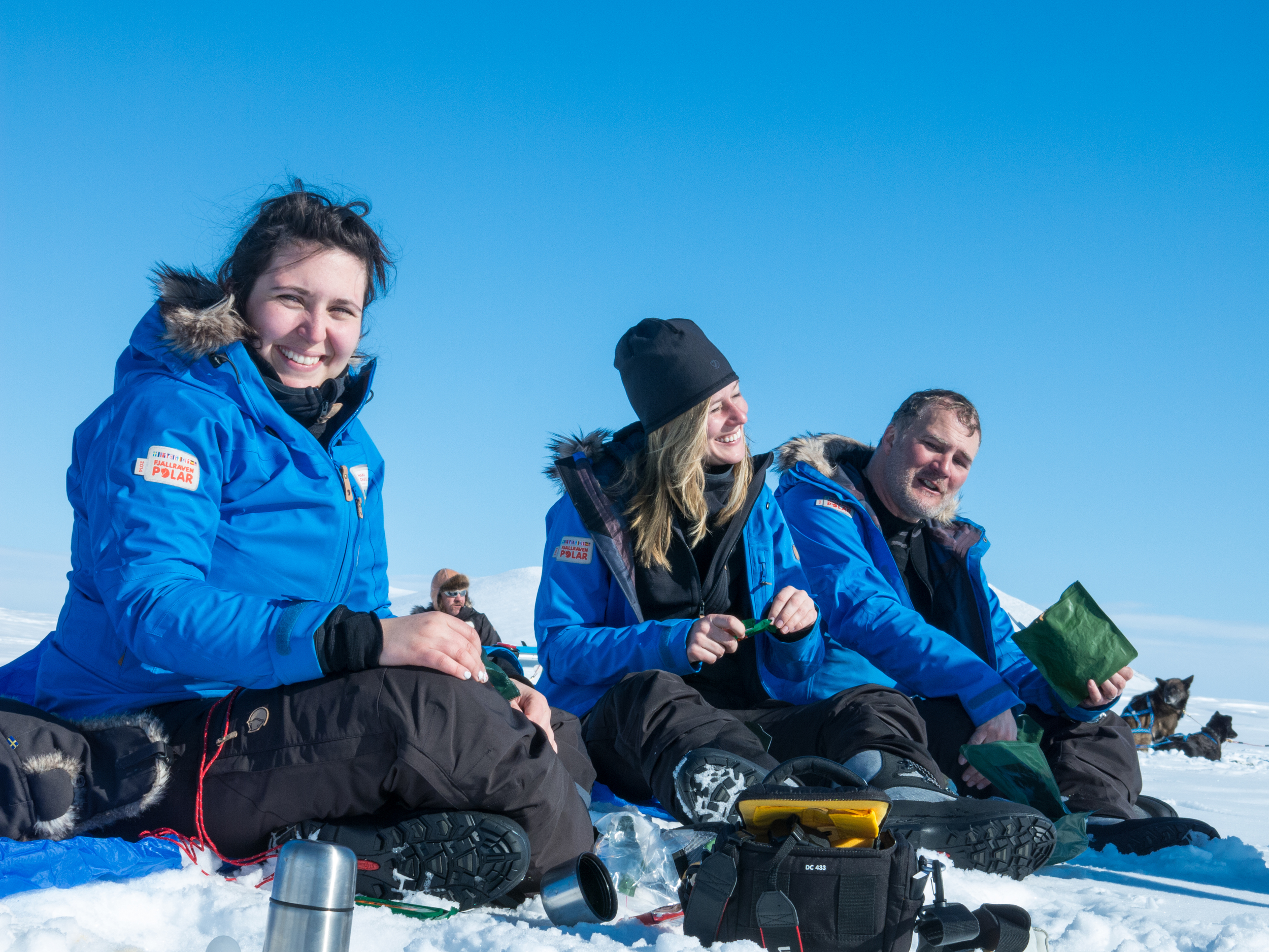 I soak up some sun during a brief lunch break with teammates Hana Chatila (Sweden) and Greg Lindstrom (USA). (Photo by Madeleine Hanssen. All rights reserved.)