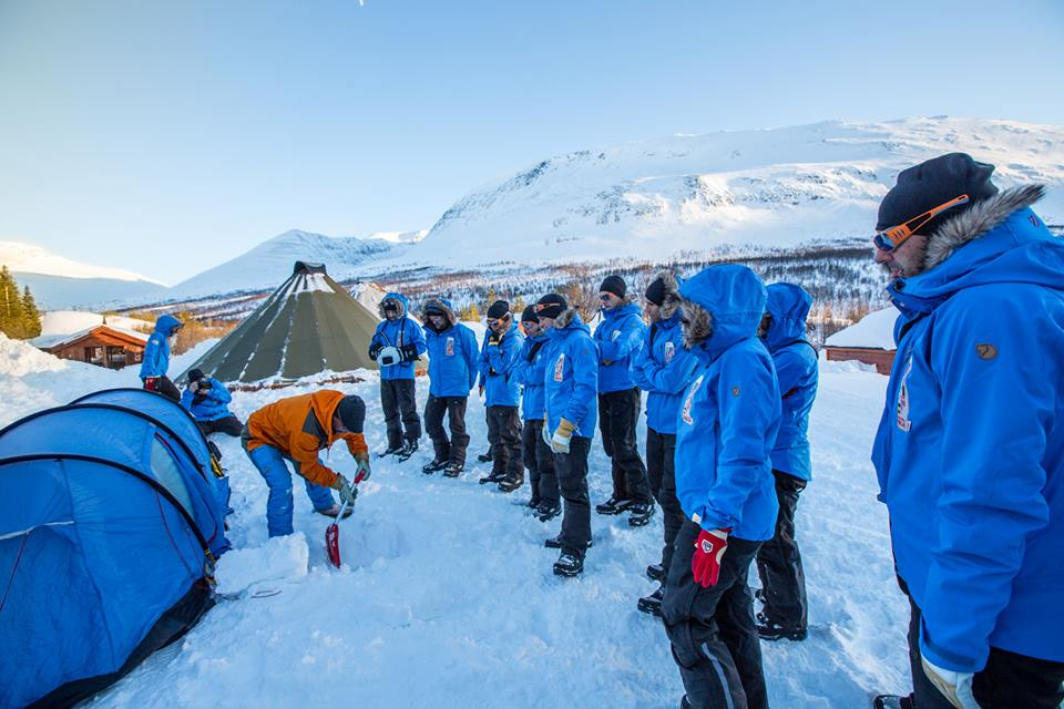 In the relatively protected environment of the Tamok Valley, Fjällraven outdoor expert Johan Skullman instructs Polar participants on the mechanics of pitching a tent in winter conditions. (Photo by Peter Holly. All rights reserved.)