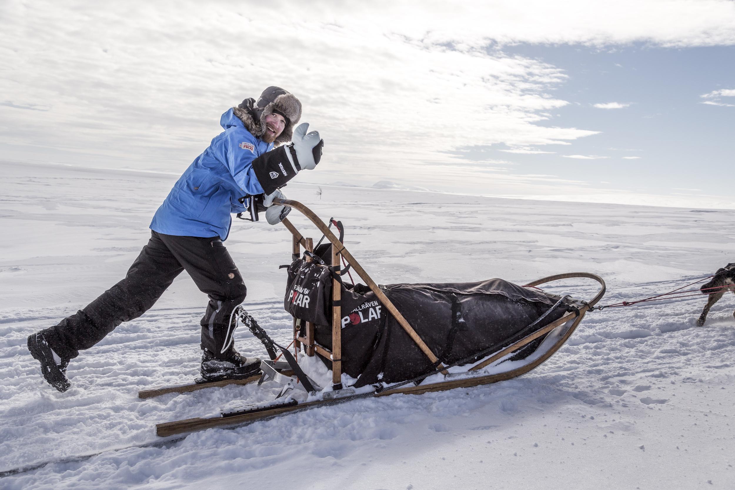 Finnish Fjällräven Polar participant Tuomo Lampela masters the art of sledding on one runner.(Photo by Håkan Wike for Fjällräven International. All rights reserved.)