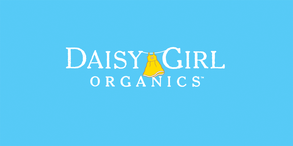 Daisy Girl Organics iconic yellow dress symbolizes a fresh and youthful spirit with universal appeal that reflects the fresh, sweet flavor of the Daisy Girl apple variety.