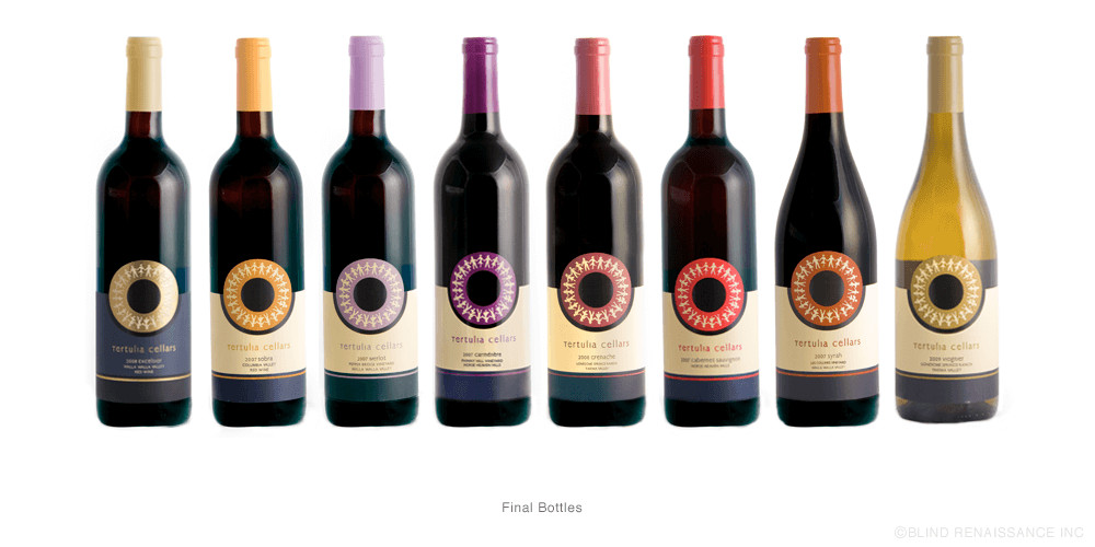 Final bottles have a varnish over the circle of friends icon and variety text while Reserve wines, such as Excelsior (far left), have gold foil and a dark blue background.