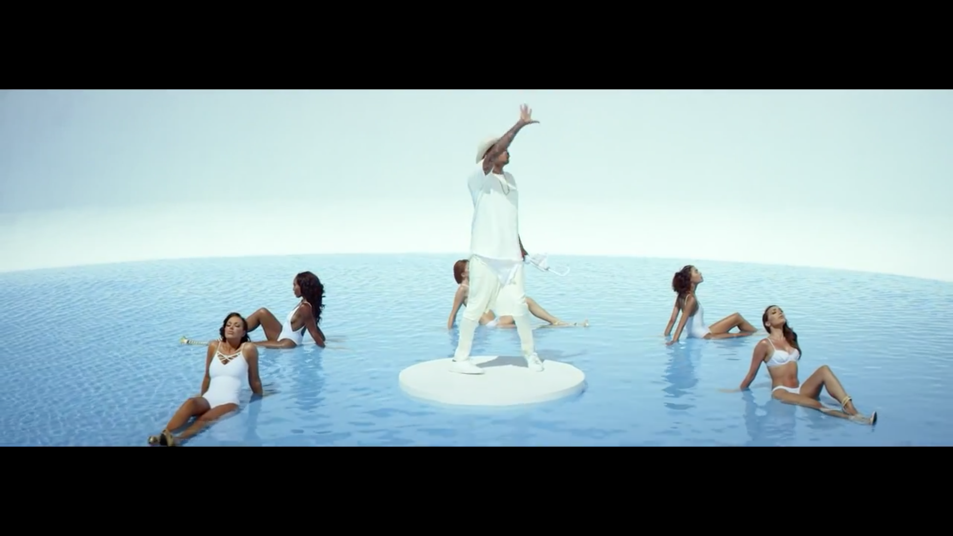 chris brown surrounded by girls new flame.jpg