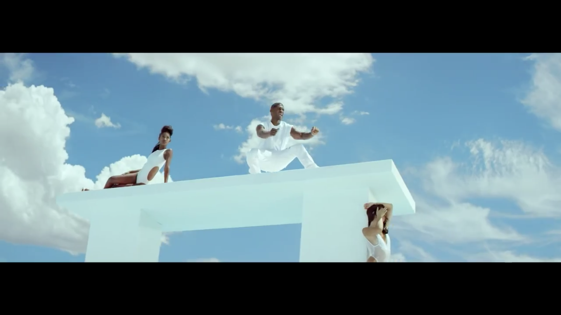 usher surrounded by girls in new flame.jpg