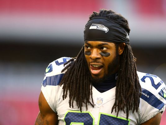 richard sherman looking hot on the field with his tongue poking out omg I can't handle this.jpg