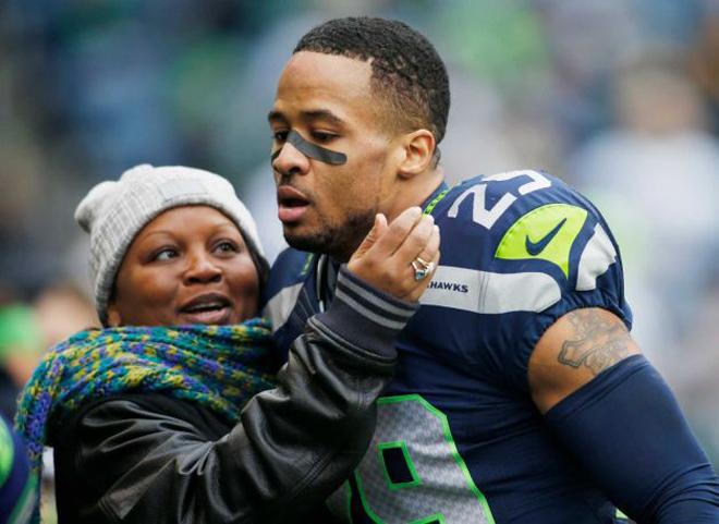 Earl Thomas III loving his mom on the field.jpg