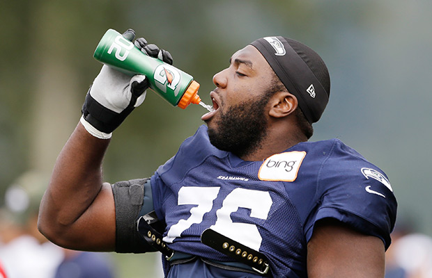 Russell Okung squirting water into his mouth.jpg