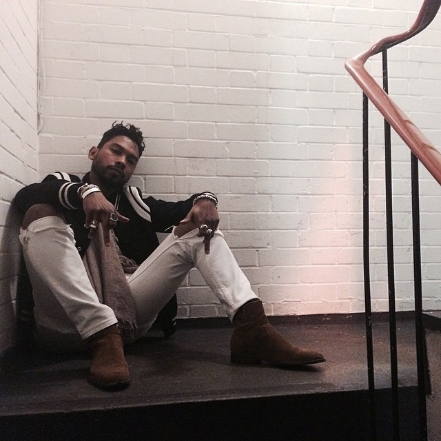 Miguel looking SO HOT in an indoor stairwell.jpg