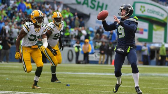 Jon Ryan passing the football to Garry Gilliam to complete the fake.jpg