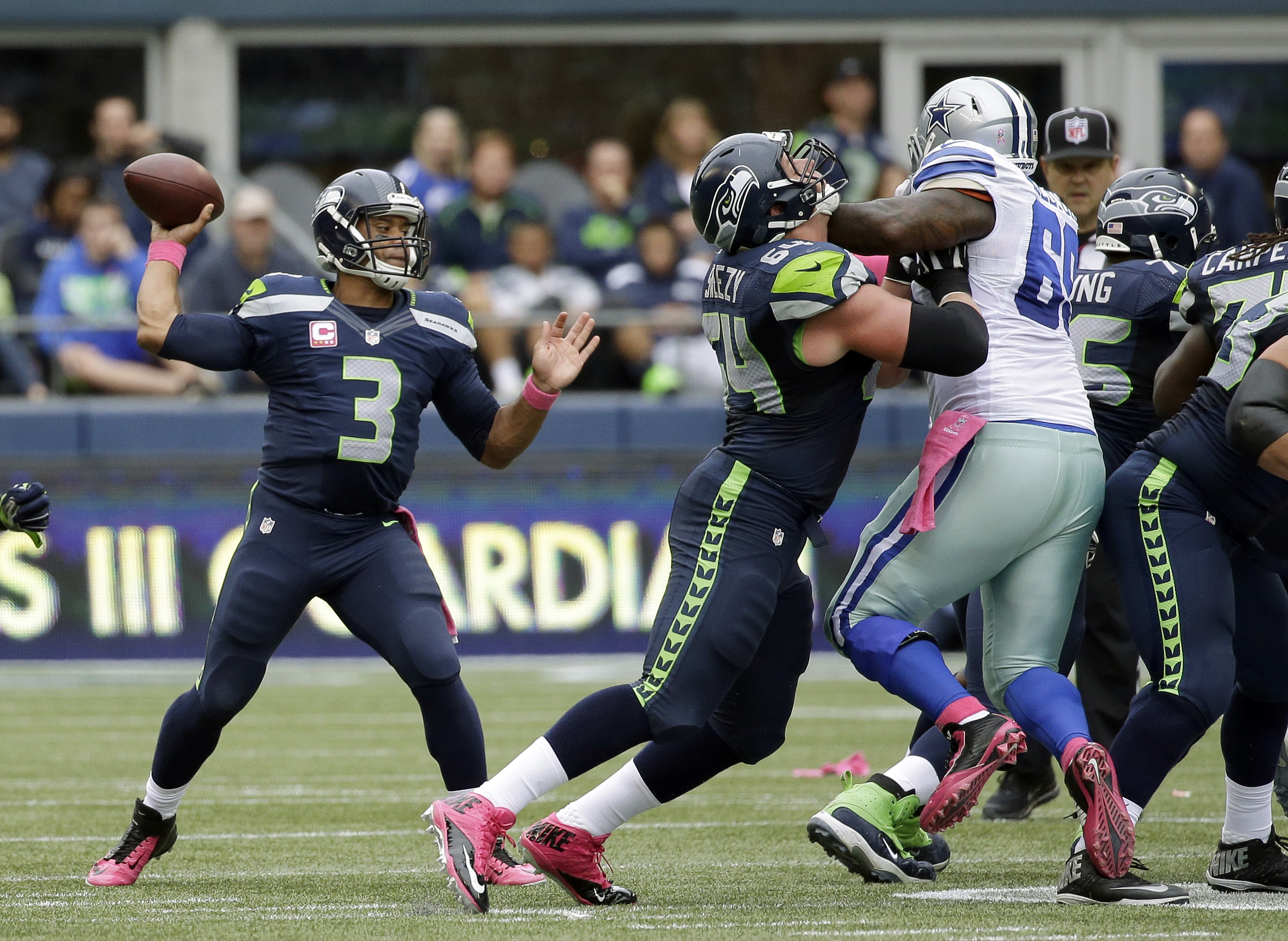 J.R. Sweezy protecting the hottest quarterback in the NFL aka Russell Wilson.jpg