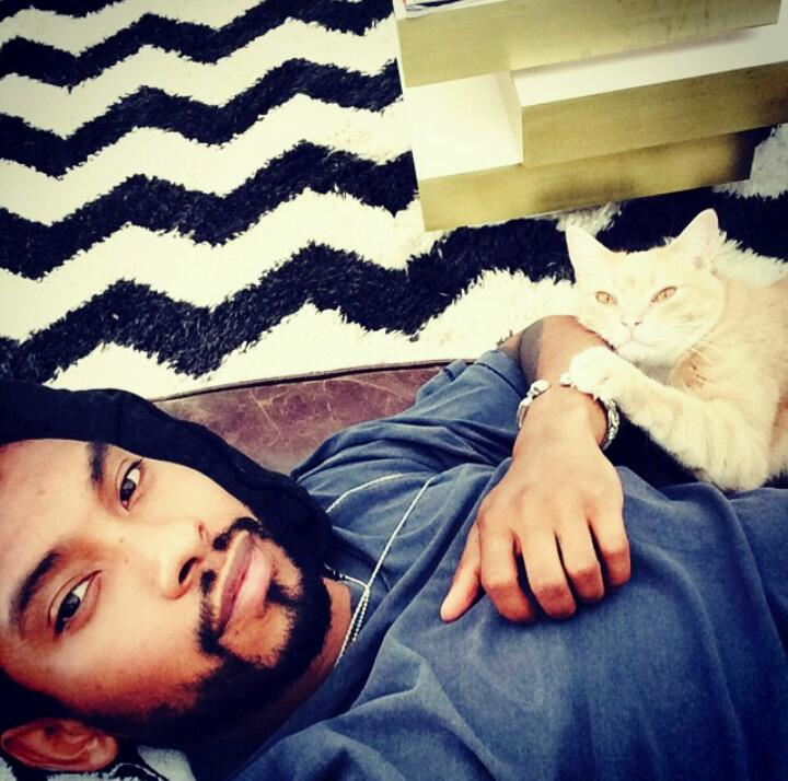 Miguel relaxing and looking hot with his cat.jpg