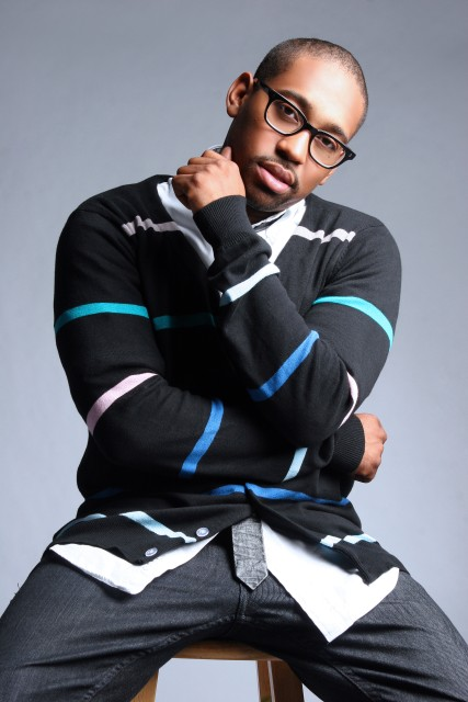 PJ Morton looking really hot sitting on a stool.jpg