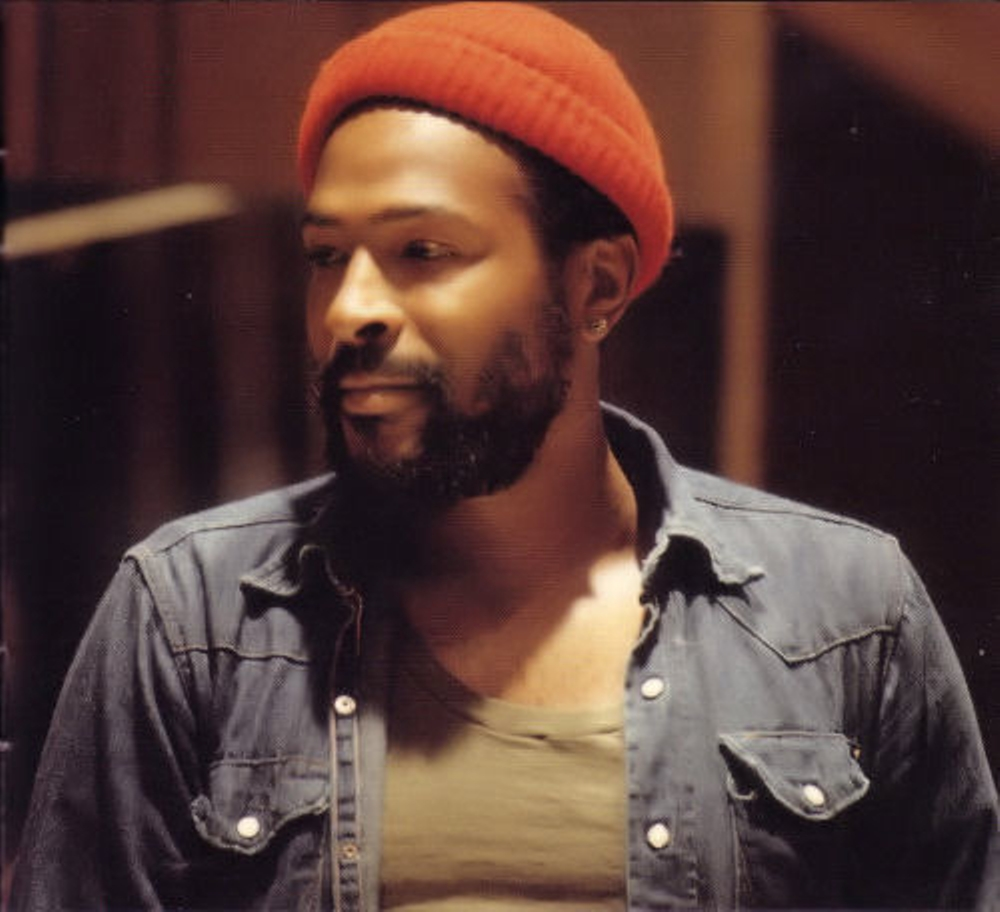 Marvin Gaye looking hot in a button down shirt and an orange hat.jpg