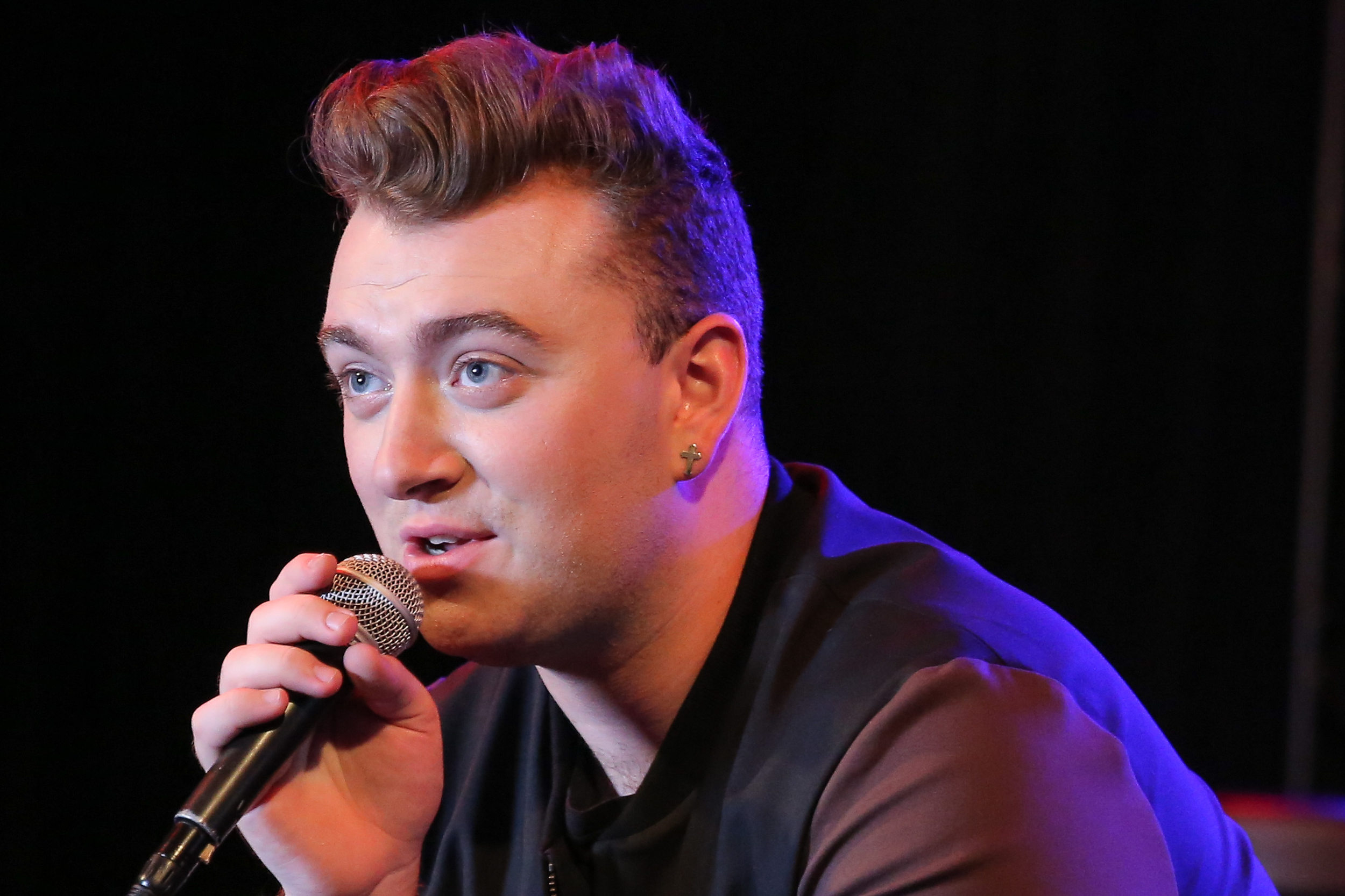 Sam Smith bellowing gibberish into the microphone.jpg