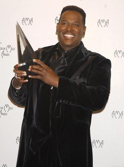 Luther Vandross holding his AMA award.jpg