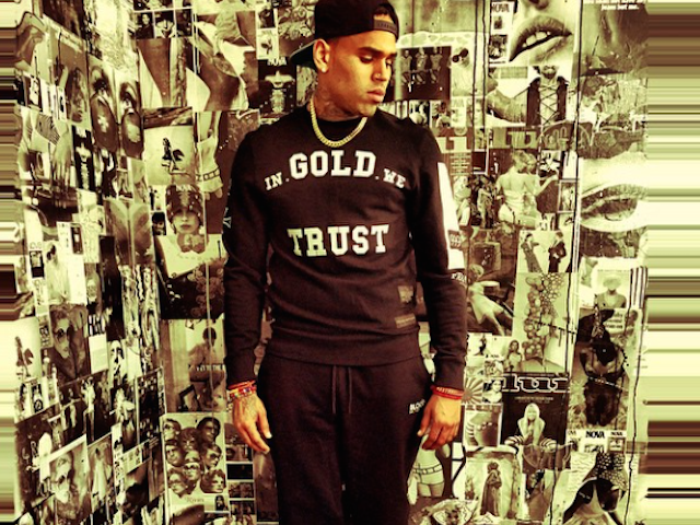 Chris Brown looking really hot in a gold room and he has a perfect outfit on too.jpg