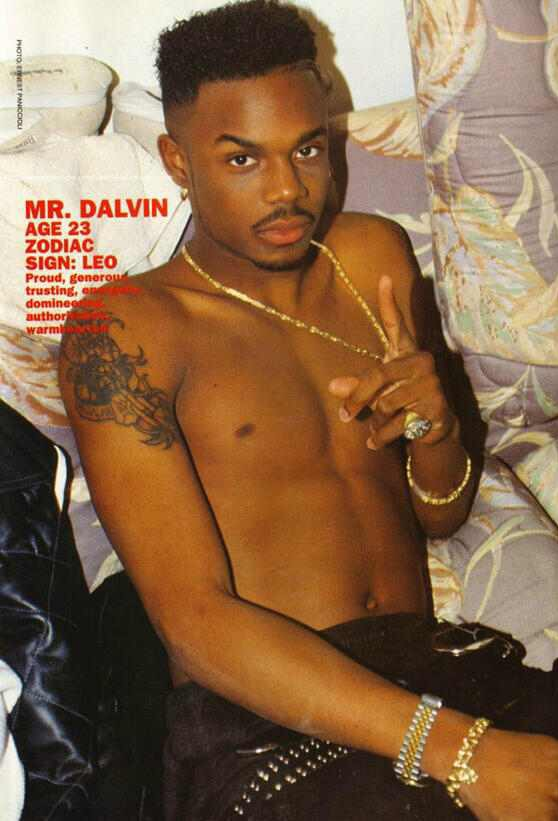 Mr Dalvin posing on the bed without a shirt on omg.jpg
