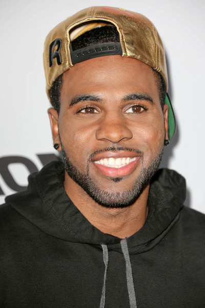 Jason Derulo wearing a black sweatshirt and a gold hat looking gorgeous as usual.jpg