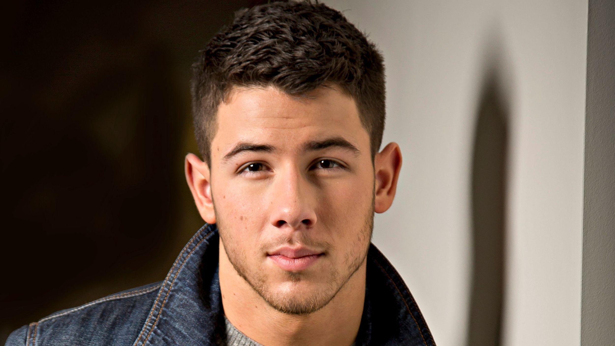 Nick Jonas looking really hot in a denim jacket.jpg