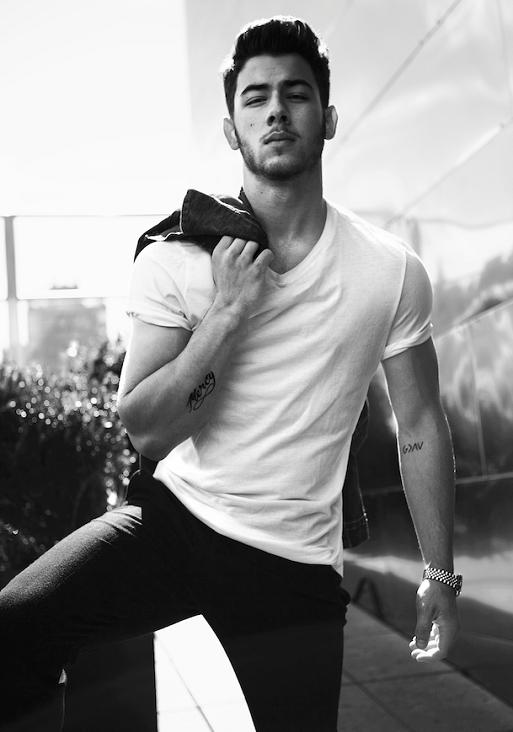 Nick Jonas looking gorgeous in a greyscale photo omg.jpg