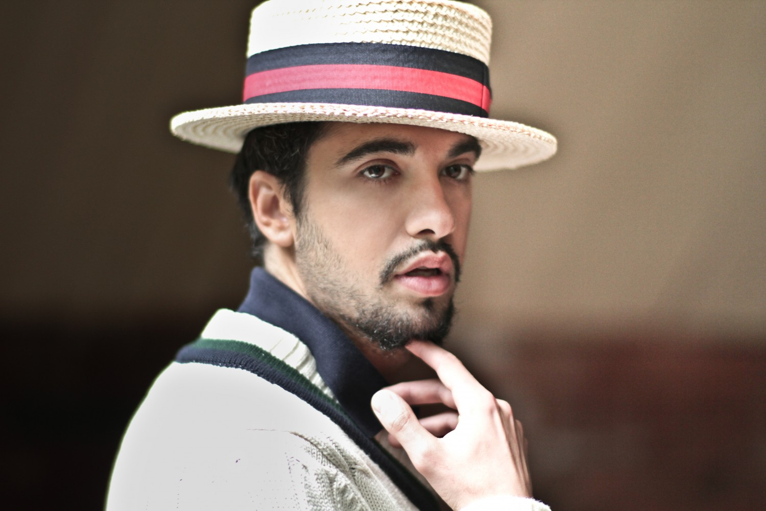 DJ Cassidy wearing a hat and looking so fucking hot as he touches his chin.jpg