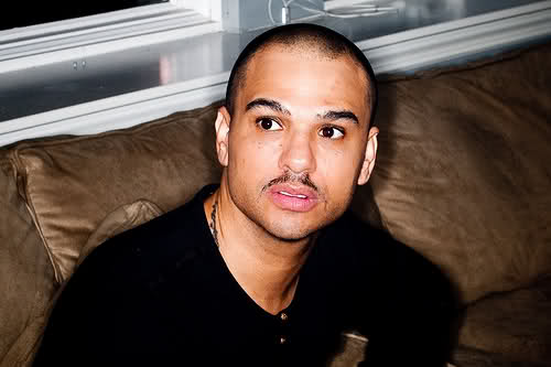 Chico DeBarge sitting on a couch looking really hot omg.jpg