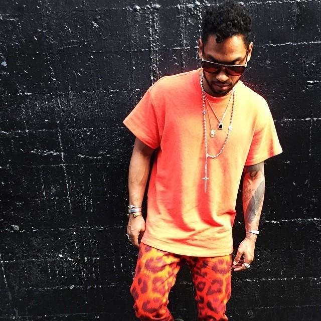 Miguel looking really hot in all orange and orange animal print pants.jpg