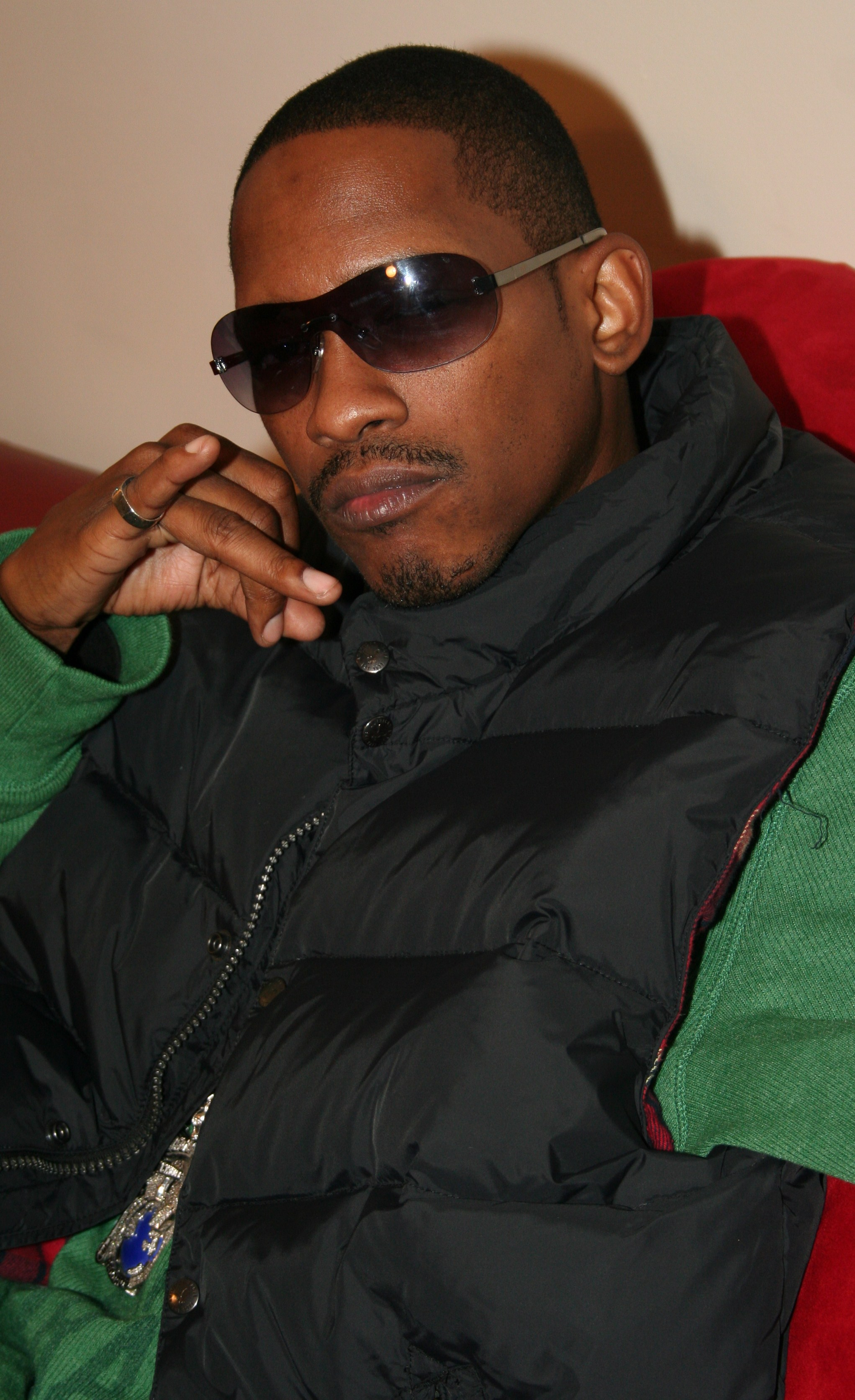 Kurupt wearing a jacket while sitting on the couch.jpg