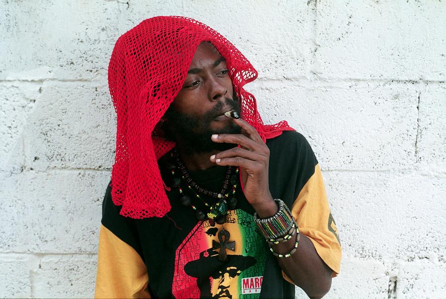 I Wayne smoking and looking hot up against a painted white cinderblock brick wall.jpg