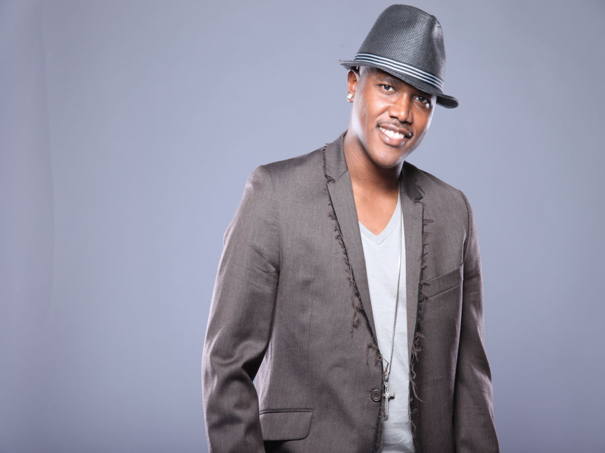 Kevin Lyttle wearing a fedora and a blazer and looking hot.jpg