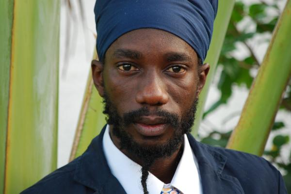 Sizzla looking gorgeous in a suit and his head scarf.jpg